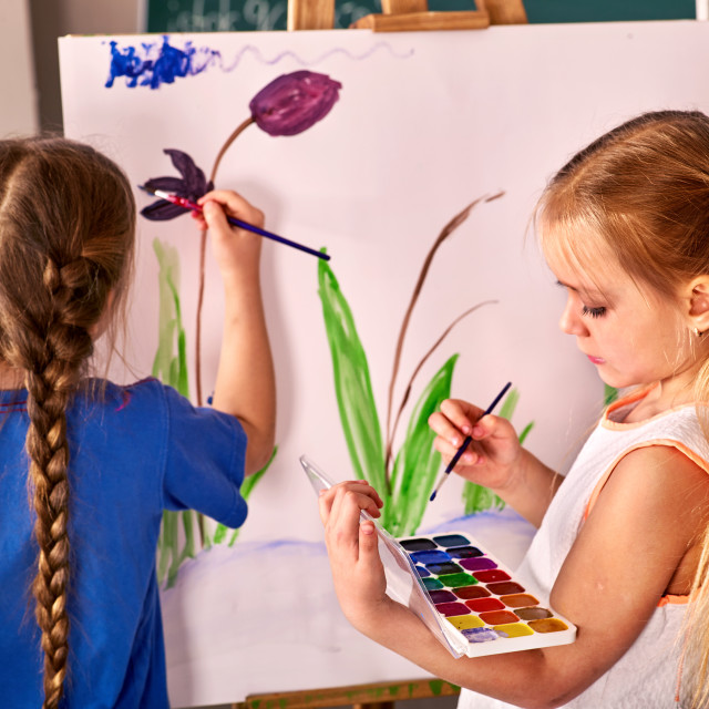 """""""Children paint on an easel"""" stock image"""