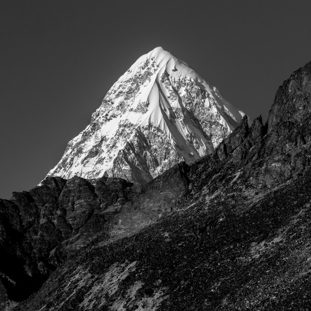 """Pumori in black & white. A distant view."" stock image"