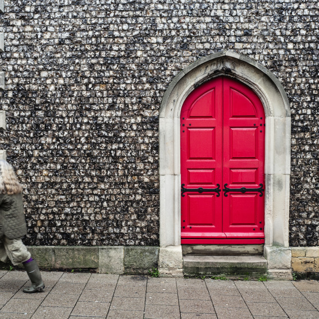 """Red Door and Person"" stock image"