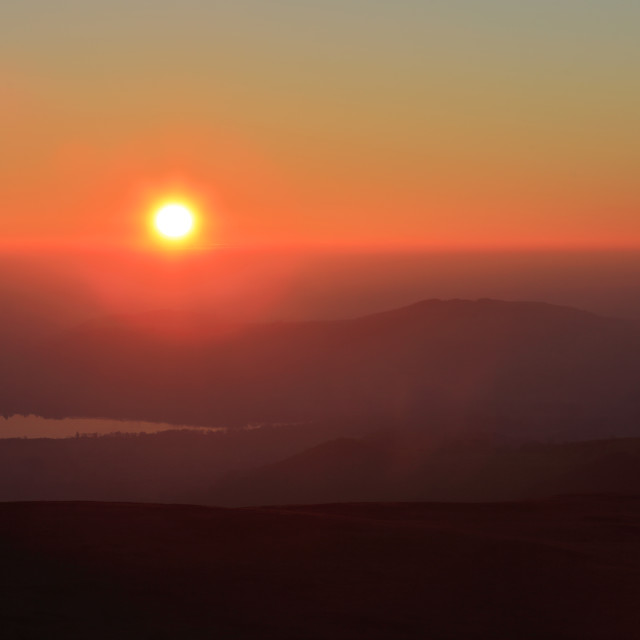 """Sunset over Bassenthwaite lake, Keswick town, Lake District National Park,..."" stock image"