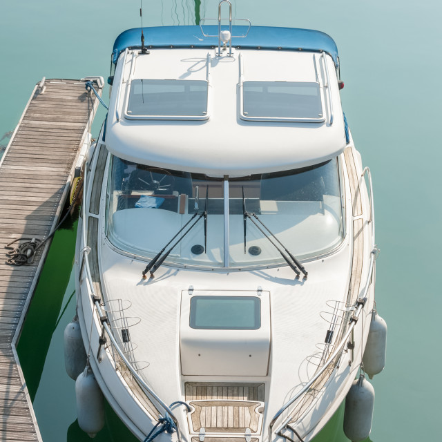 """""""small boat moored on calm water"""" stock image"""