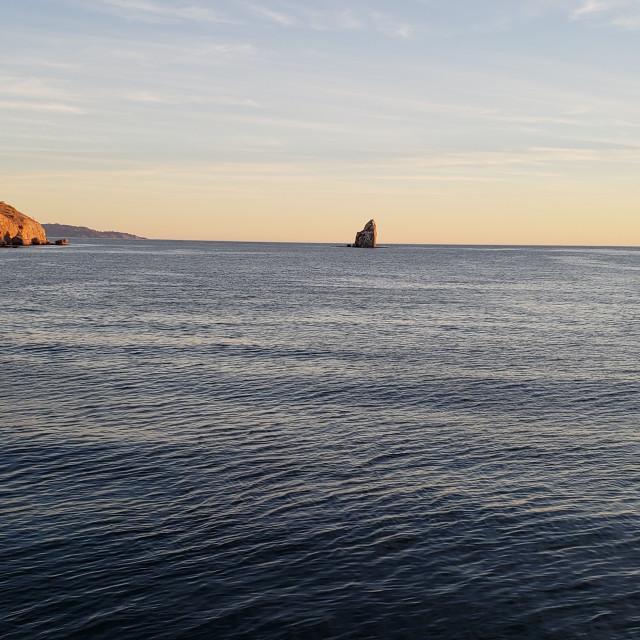 """Paddleboarder in the Sea of Cortez, Baja California, Mexico"" stock image"