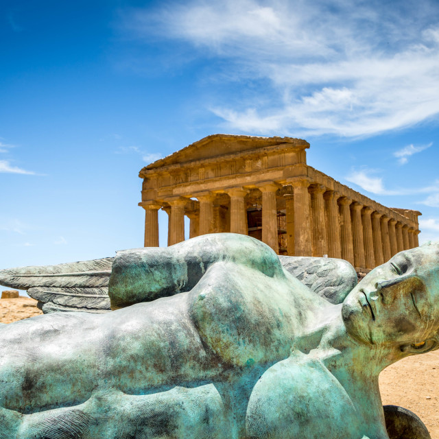 """""""Icarus bronze statue and Temple of Concordia in the Valley of Temples in Agrigento, Sicily, Italy"""" stock image"""