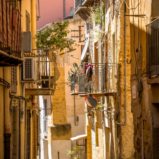"""""""Narrow scenic street in Ragusa, Sicily, Italy with old townhouses"""" stock image"""