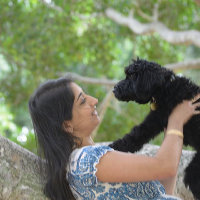 """Dog with Girl"" stock image"