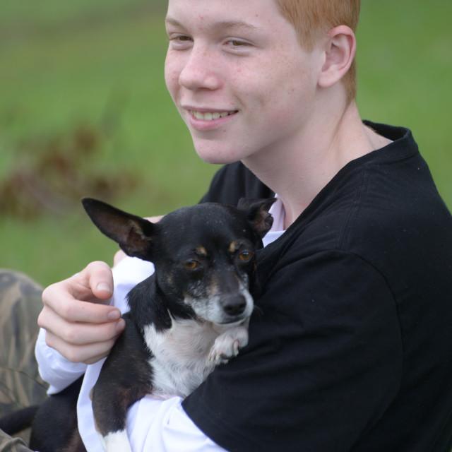 """Teenage Boy with his Dog"" stock image"