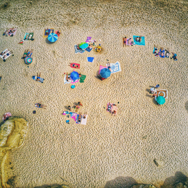 """Aerial View of People on the Sand Beach - Summer Vibes"" stock image"