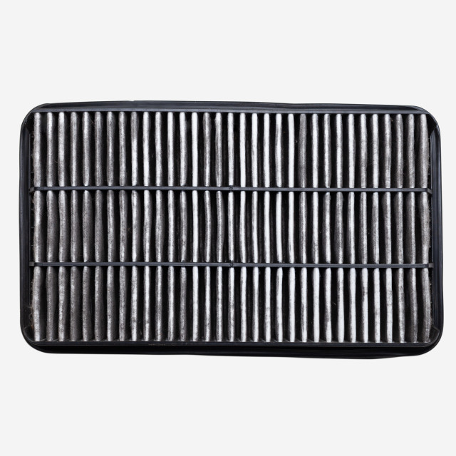 """Bottom side of dirty car air filter isolated on white background"" stock image"