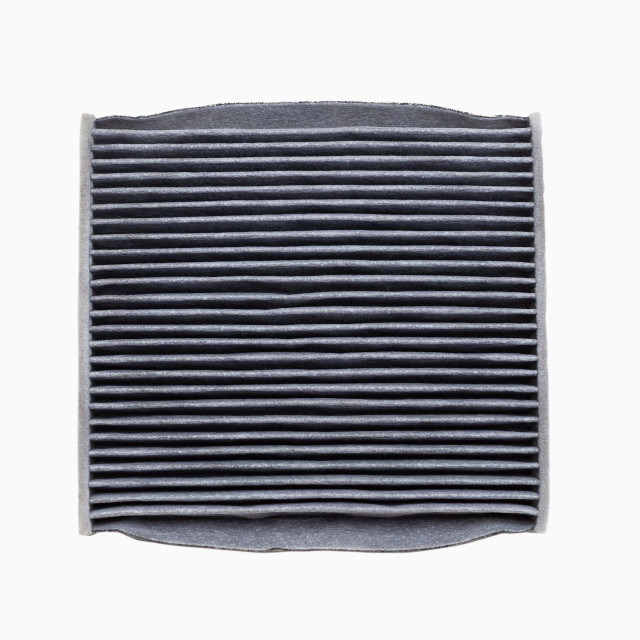 """Dirty car air conditioning filter isolated on white background"" stock image"