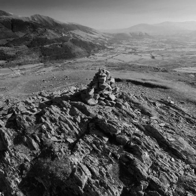 """Summit cairn on Barf fell, Bassenthwaite lake, Keswick town, Lake District..."" stock image"