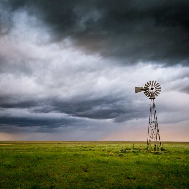 """Rural Windmill Under a Stormy Sky"" stock image"