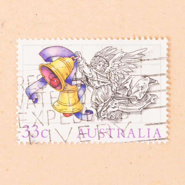 """""""AUSTRALIA - CIRCA 1980: A stamp printed in Australia shows an angel with..."""" stock image"""