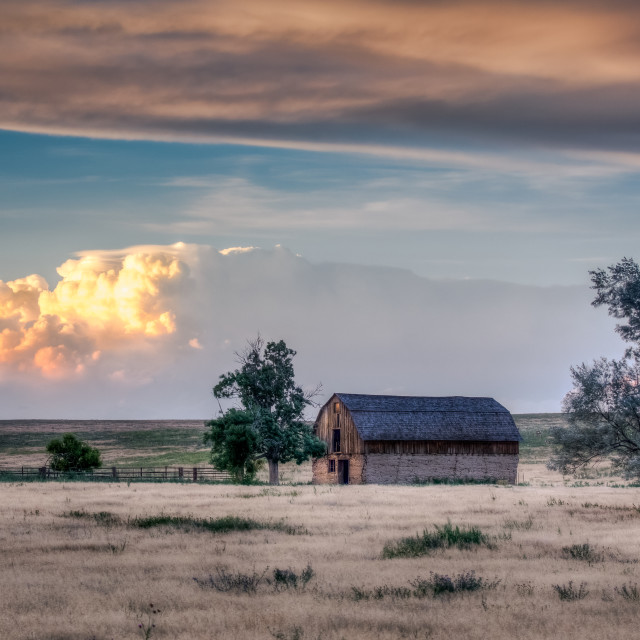 """Old Barn with a Thunderstorm in the Background"" stock image"