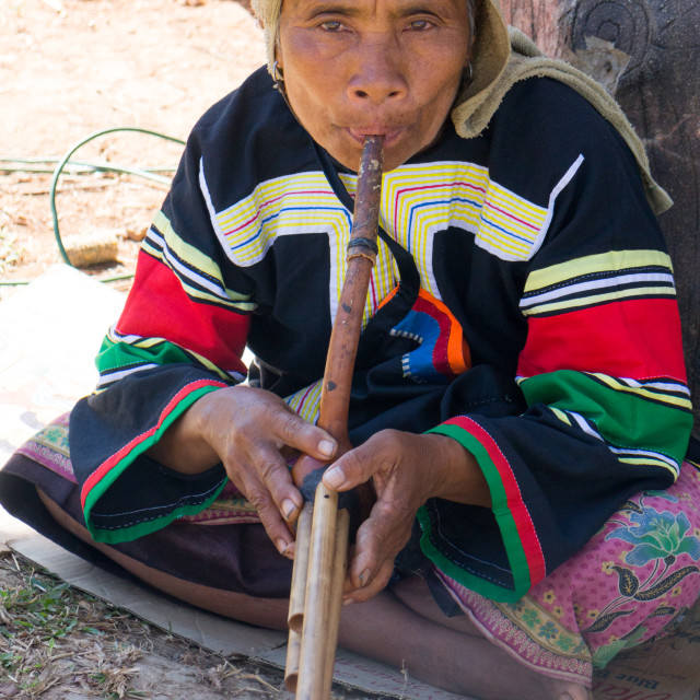 """""""Lahu hilltribe woman playing a wind instrument in Chiang Rai province, Thailand"""" stock image"""