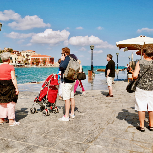 """""""Tourists at the Venetian Harbour in Chania"""" stock image"""