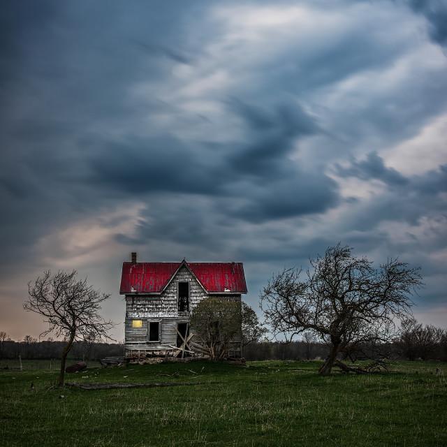 """Night falling over Abandoned House"" stock image"