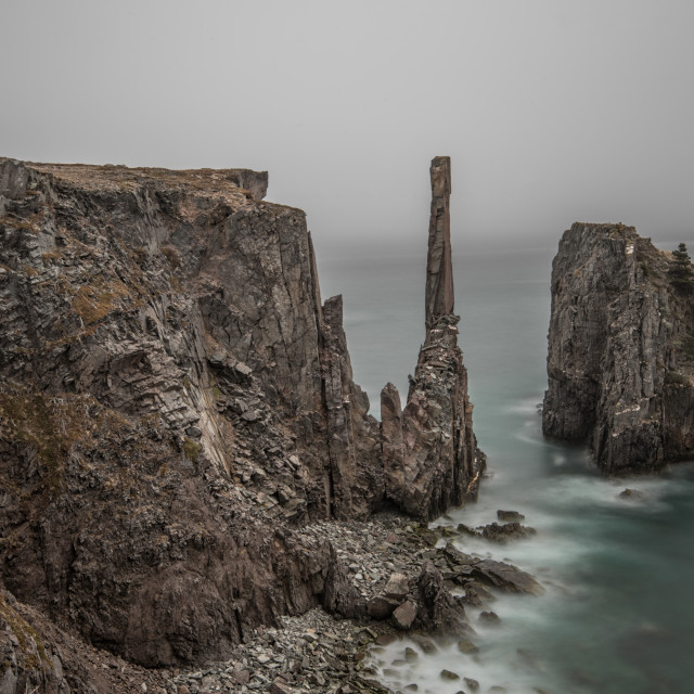 """""""Spillar's Cove surrounded by fog"""" stock image"""
