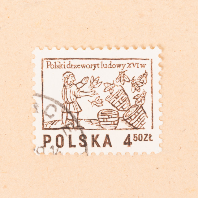 """""""POLAND - CIRCA 1970: A stamp printed in Poland shows a beekeeper with his..."""" stock image"""