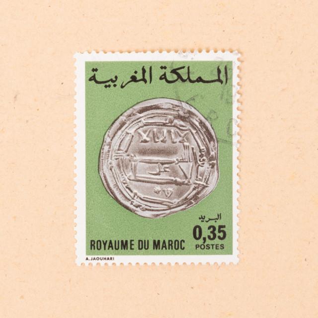 """""""MOROCCO - CIRCA 1980: A stamp printed in Morocco shows an old coin, circa 1980"""" stock image"""