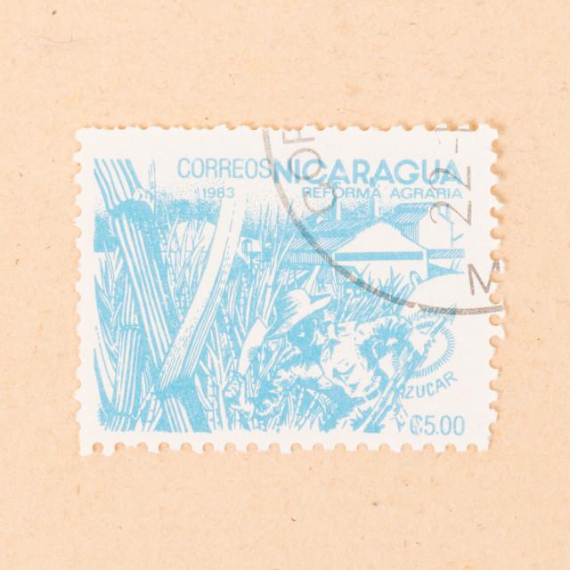 """NICARAGUA - CIRCA 1983: A stamp printed in Nicaragua shows teh agrarian..."" stock image"