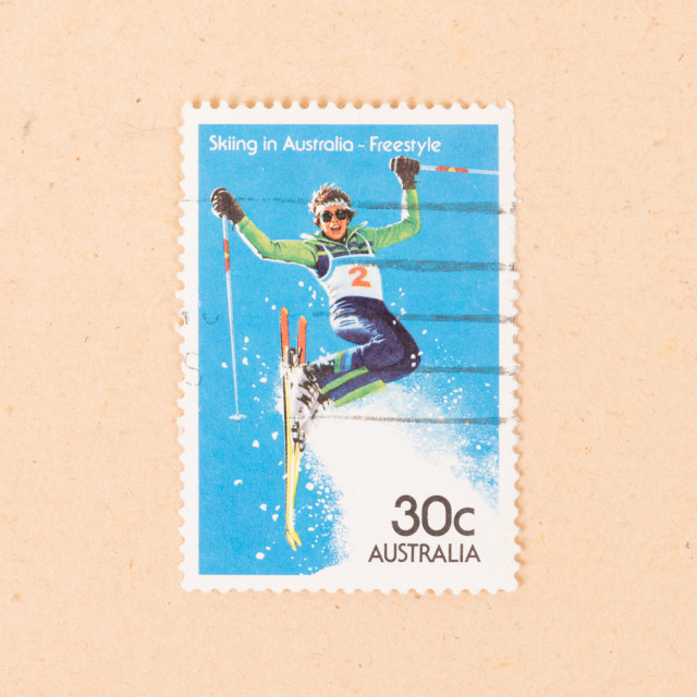 """""""AUSTRALIA - CIRCA 1980: A stamp printed in Australia shows a woman skiing in..."""" stock image"""