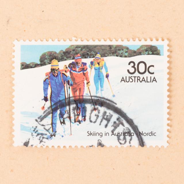 """AUSTRALIA - CIRCA 1980: A stamp printed in Australia shows three men skiing..."" stock image"