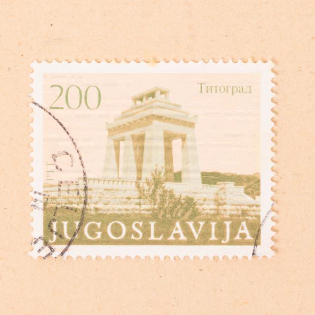 """JUGOSLAVIA - CIRCA 1980: A stamp printed in Jugoslavia shows a building,..."" stock image"