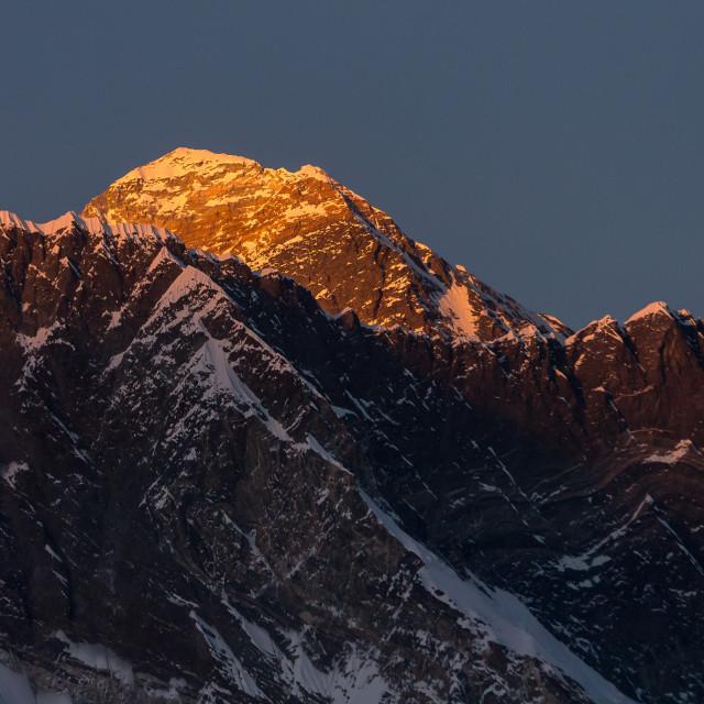"""Mt. Everest rising above the Nuptse-Lhotse Ridge at sunset"" stock image"