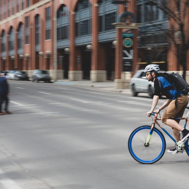 """Man riding fast on a mountain bike"" stock image"