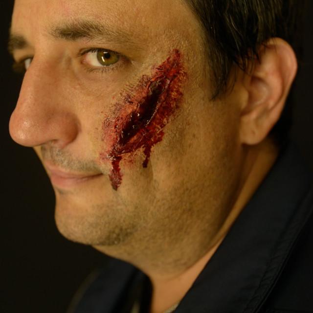 """Profile of Scar Face"" stock image"