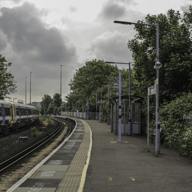 """""""Moving train from station at Hither Green"""" stock image"""