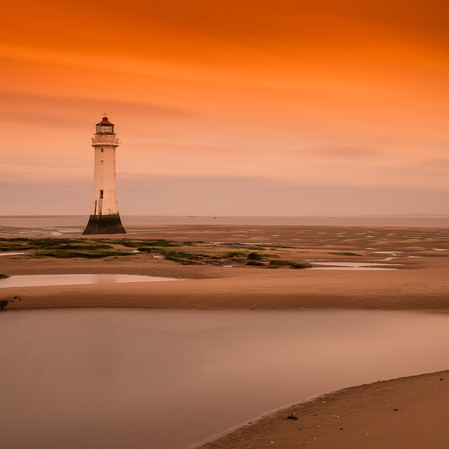 """Sunrise at Perch Rock"" stock image"