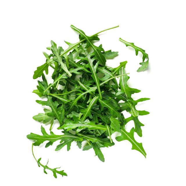 """Heap of arugula leaves isolated"" stock image"