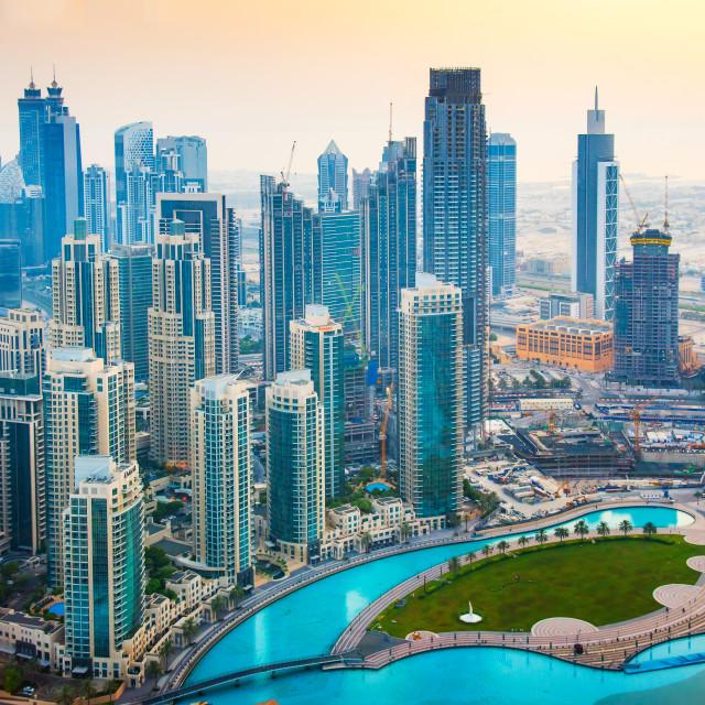 """Dubai downtown skyline and Burj Khalifa Lake at sunset"" stock image"