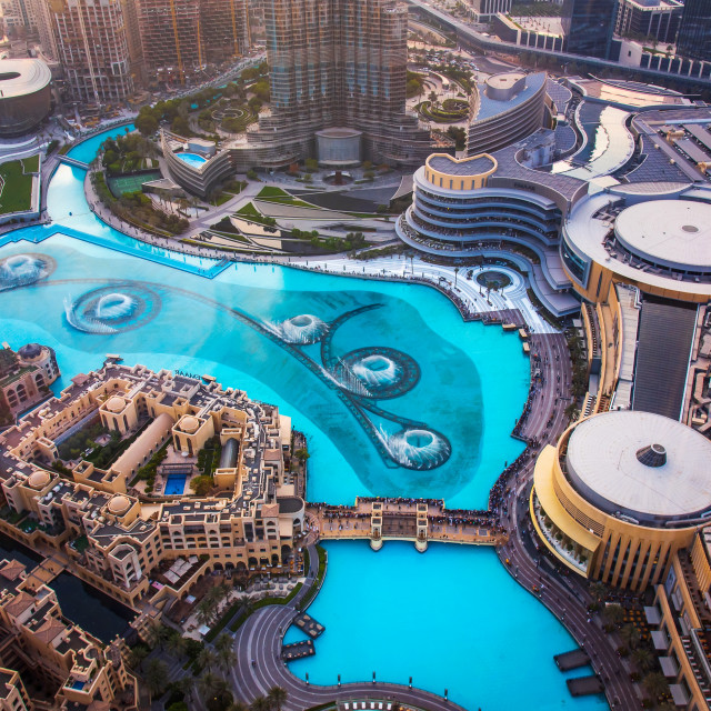 """""""Dubai mall fountain show surrounded and modern downtown buildings top view"""" stock image"""
