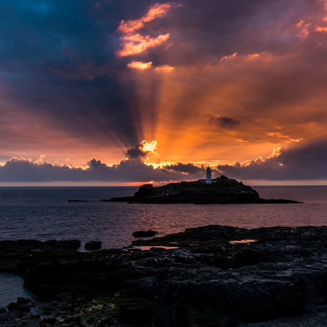 """Dramatic sunset at Godrevy"" stock image"