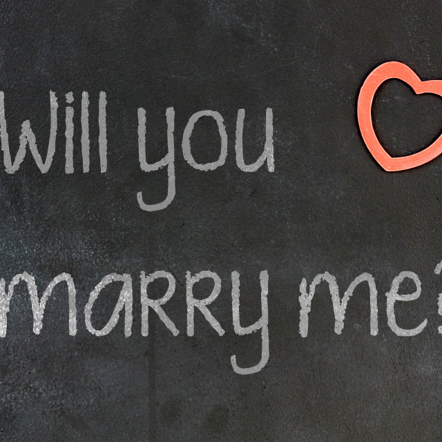 """""""Blackboard with small red heart - Will you marry me?"""" stock image"""