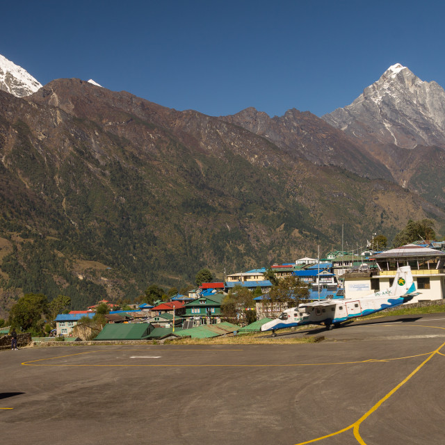 """""""Tara Air aircraft taking off from the Lukla Airport"""" stock image"""