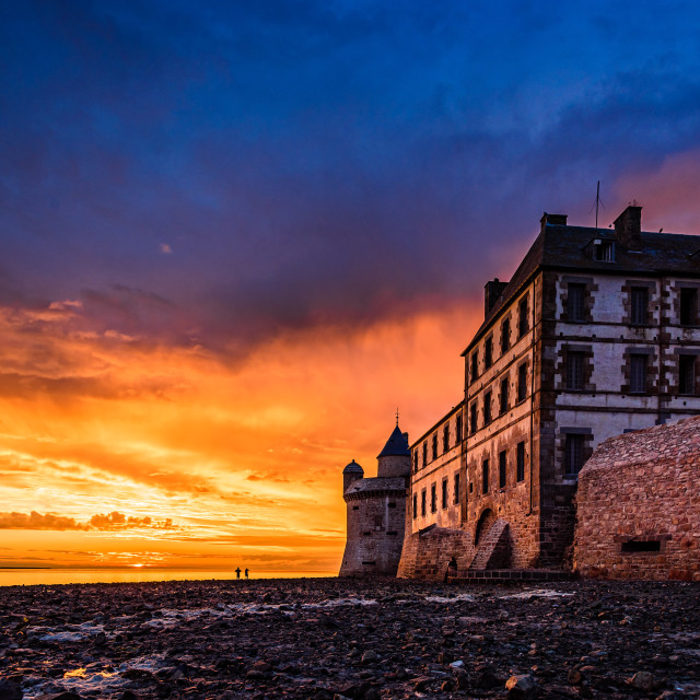 """Dramatic sunset on Mont Saint Michel, France"" stock image"