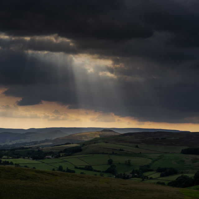 """Crepuscular rays lighting the way over The Peak District"" stock image"