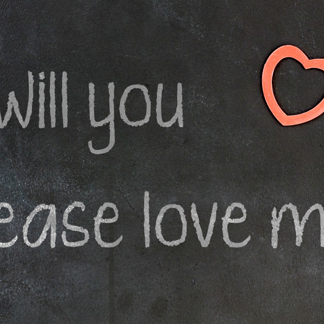 """Blackboard with small red heart - Will you please love me"" stock image"