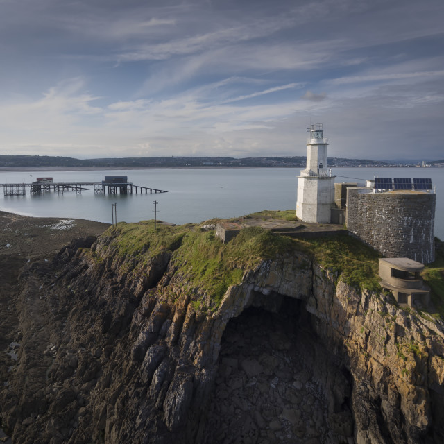 """Mumbles Lighthouse, pier and Bob's cave"" stock image"