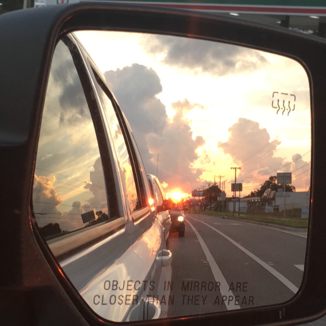 """Sunset setting in side view window"" stock image"