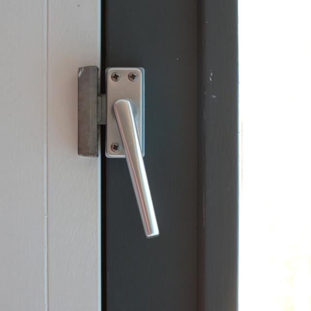 """""""Close up view of aluminum door window handle"""" stock image"""