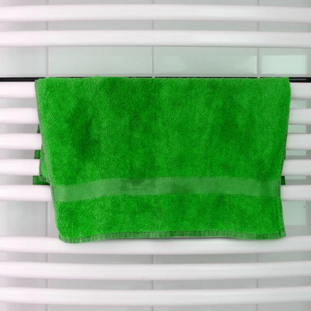 """White metal heated towel rail set in the bathroom"" stock image"