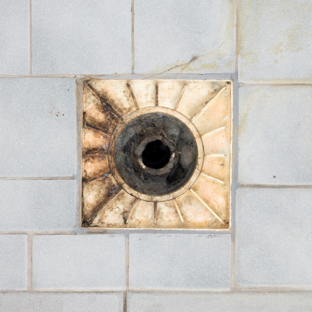 """Floor drain in an old shower"" stock image"