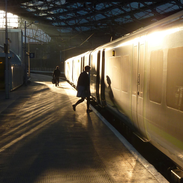 """Sunrise Silhouette boarding a train"" stock image"