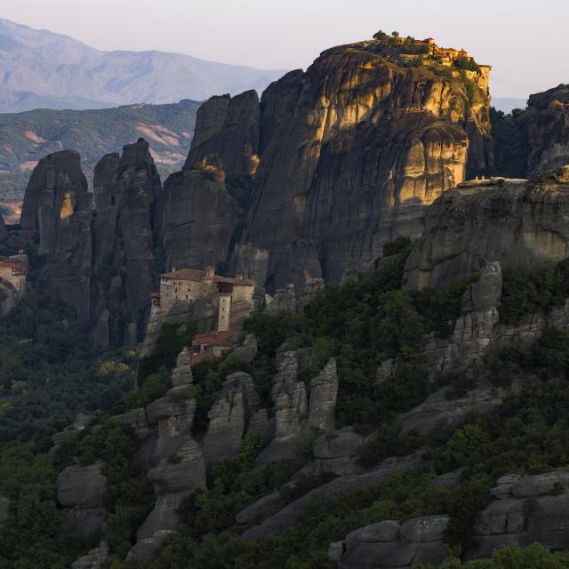 """Meteora cliffs bathed in Golden hour light."" stock image"