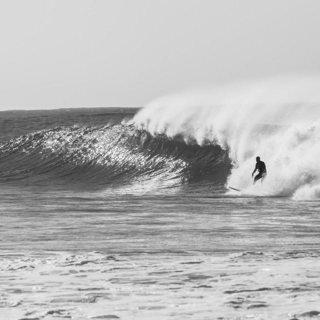 """Surfer Surfing Wave Left Behind Black White"" stock image"