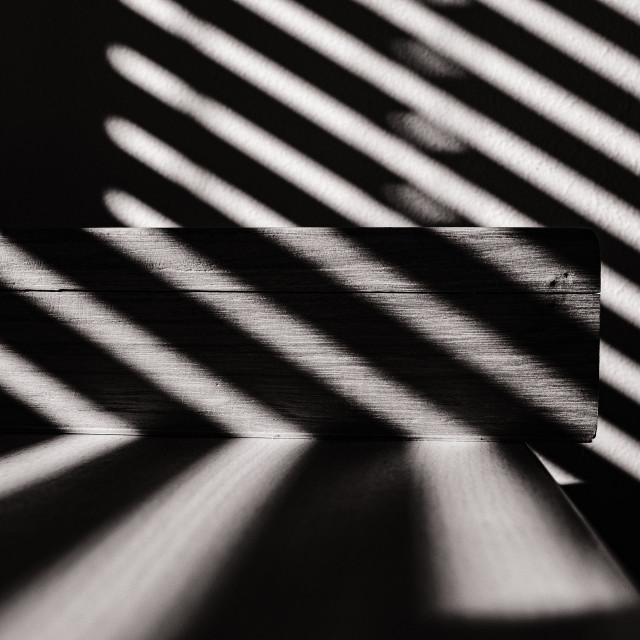 """Morning sun through the open blind"" stock image"